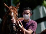 Jockeys and handlers are required to wear masks in the UK