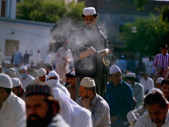 Pakistan eid disinfect worshippers