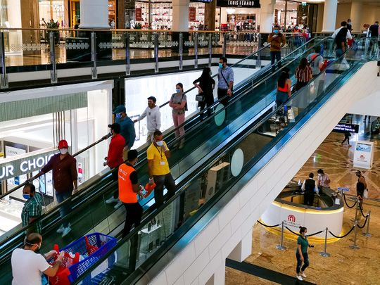 People at a mall in Dubai.