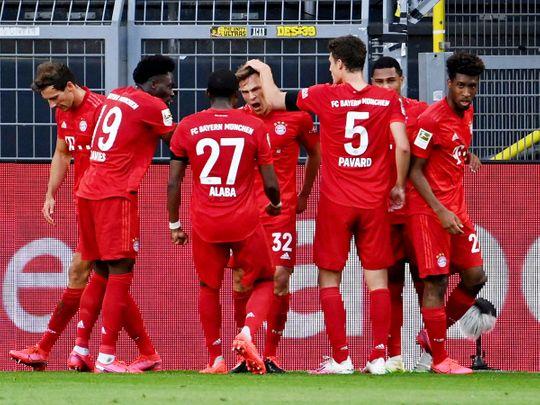 Bayern Munich's Joshua Kimmich celebrates scoring the only goal of the game against Borussia Dortmund