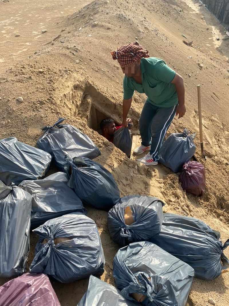Thousands of bottles of alcohol were unearthed from a hole in the Dubai desert over Eid