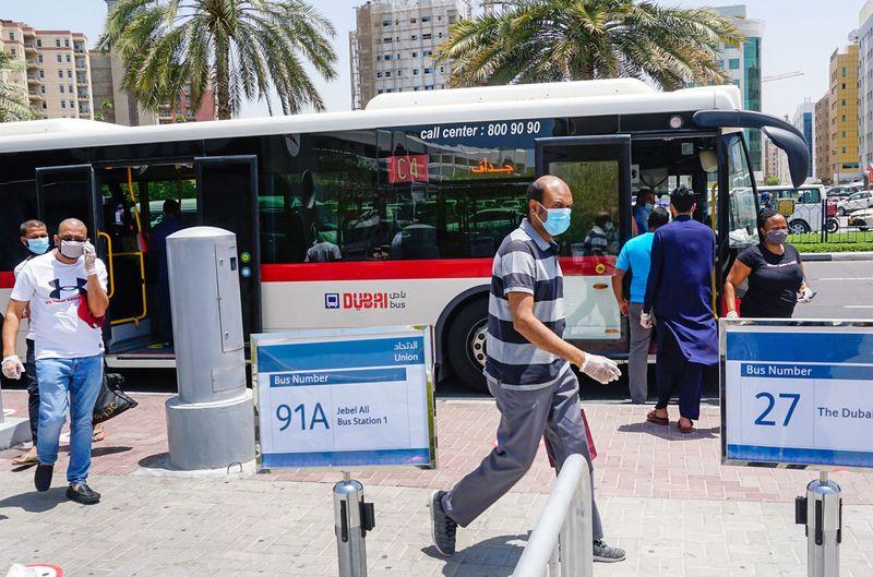 Passengers using RTA public transport bus