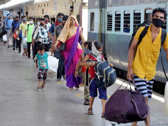 Migrants arrive to board a Shramik special trains Prayagraj Railway Station