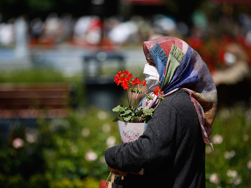 A woman wearing a face mask for protection against coronavirus walks during a four-day curfew declared by the government in Istanbul