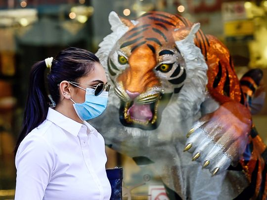 expat wearing mask, resident wearing mask, woman wearing mask, covid-19 in uae