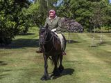 Britain's Queen Elizabeth II rides Balmoral Fern, a 14-year-old Fell pony, in Windsor