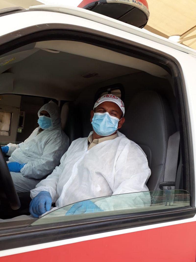 Crematorium staff in full PPE