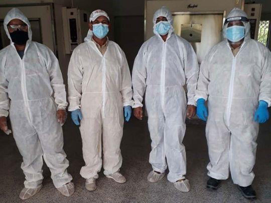 Crematorium workers in Dubai in full PPE