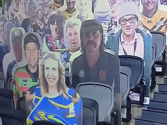 Dominic Cummings, top right, the under-fire political aide to UK Prime Minister Boris Johnson, made an appearance of sorts at an NRL match
