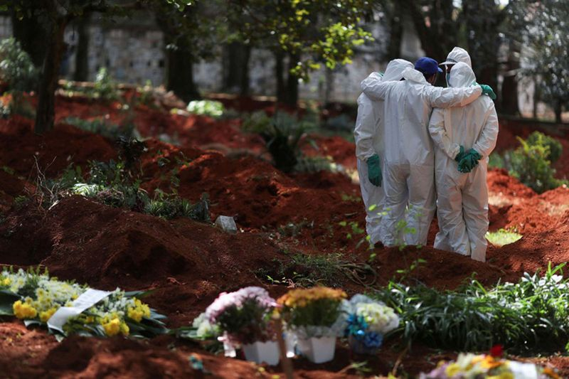 Gravediggers wearing protective suits gather at Vila Formosa cemetery, Brazil's biggest cemetery, during the COVID-19 outbreak, in Sao Paulo, Brazil, April 2, 2020.