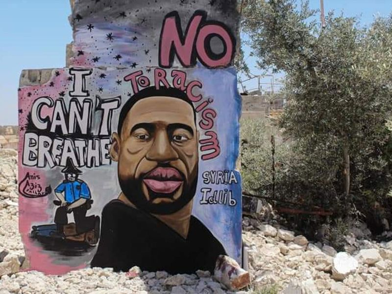 Artists paint a mural of George Floyd in war-torn Syria