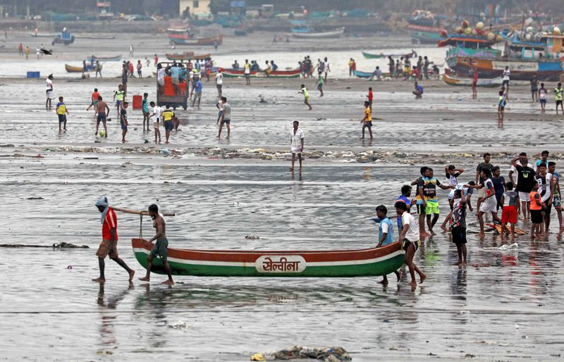 Fishermen take precautions by anchoring their boats at Uttan beach ahead of the Cyclone Nisarga, in Thane.