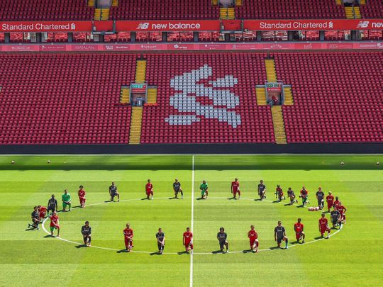 Liverpool players take a knee for George Floyd during training at Anfield.