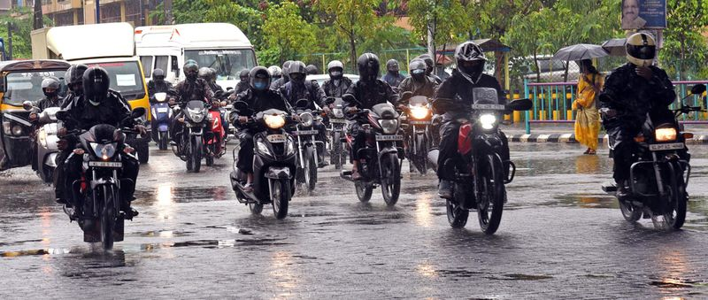 Vehicular movement seen on a road during rain, in Kochi on Tuesday.