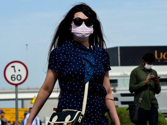 woman wearing mask, covid-19 in uae, people wearing masks