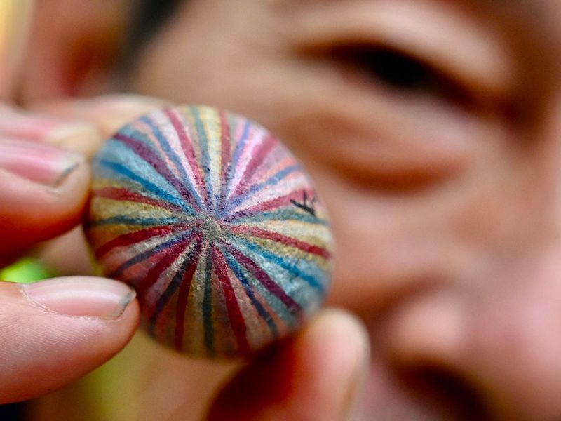 Taiwan's 'Uncle Stone' turns pebbles into colourful keepsakes