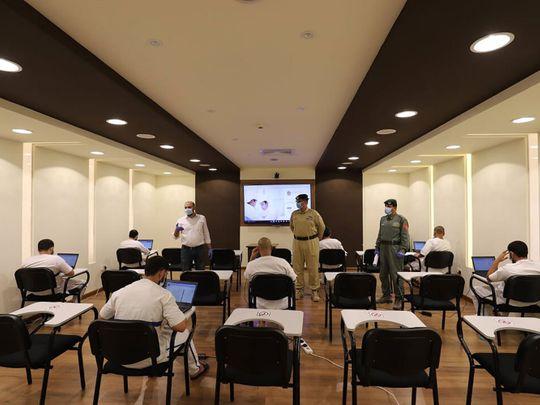Dubai inmates taking the exams