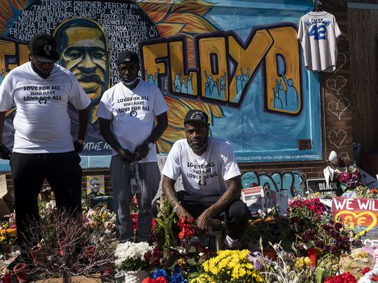 Former NBA player Stephen Jackson (R), a friend of George Floyd's, poses for a photograph at a memorial for Floyd in Minneapolis, Minnesota.