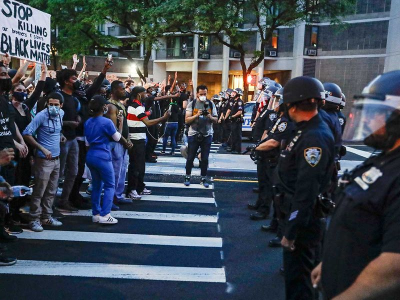 Protesters confront New York Police officers Floyd George