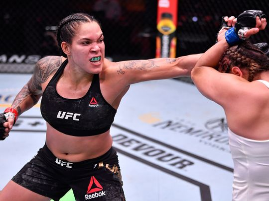 Amanda Nunes punches Felicia Spencer during their UFC featherweight championship bout