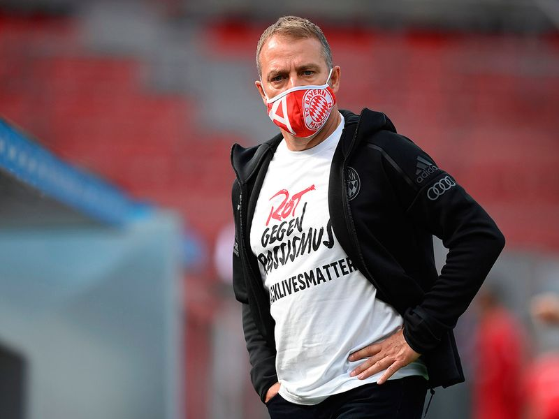 Bayern Munich's German head coach Hans-Dieter Flick wears a Tshirt with a message reading