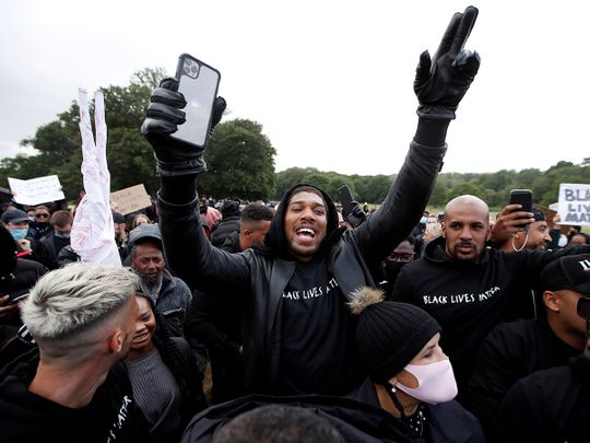 Boxer Anthony Joshua is seen with demonstrators during a Black Lives Matter protest in Watford, following the death of George Floyd who died in police custody in Minneapolis, Watford, Britain, June 6, 2020.
