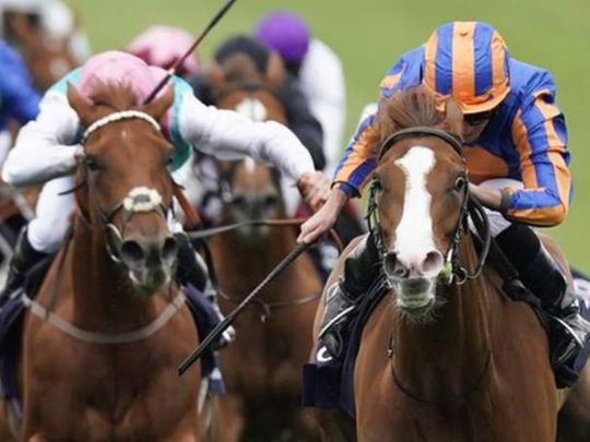 Love wins the 1,000 Guineas at Newmarket.