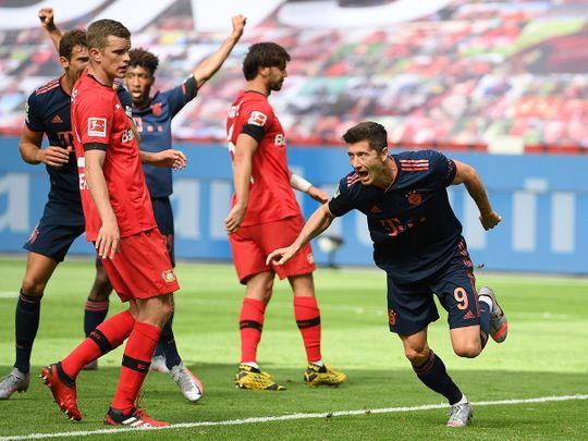 Robert Lewandowski celebrates scoring against Bayer Leverkusen.