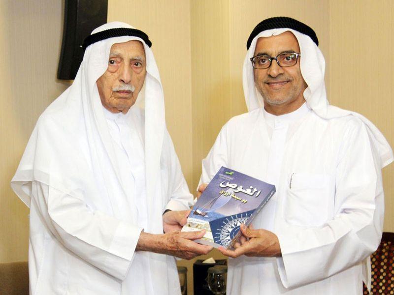 The author Ahmad Mohammad Al Thani with Jumaa Al Majed