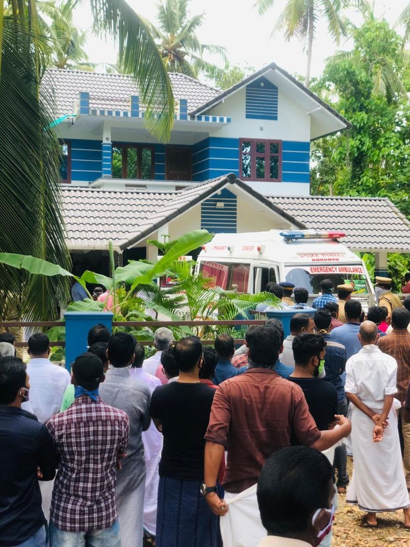 A crowd of mourners gathers for Nithin's funeral in Kerala on Wednesday