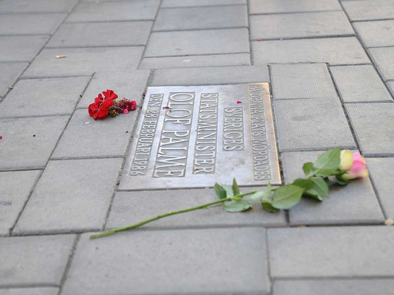 Flowers are placed next to a plaque on Sveavägen in Stockholm  Olof Palme