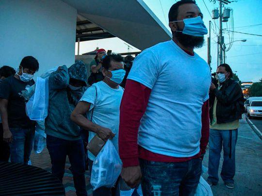 Migrants Guatemalans masks