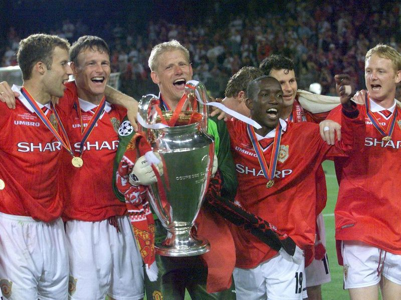 Peter Schmeichel and Manchester United with the Champions League trophy.