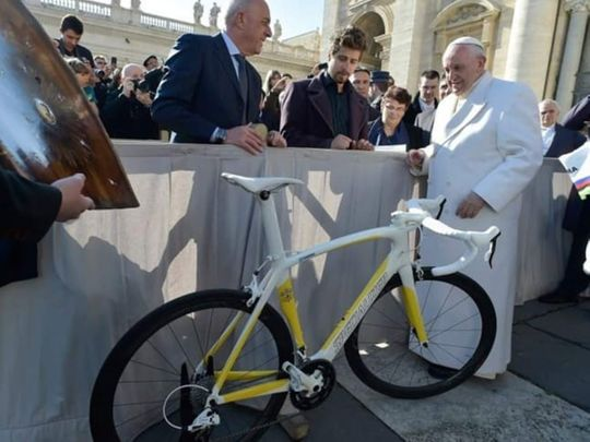 Pope with the bike donated by Sagan