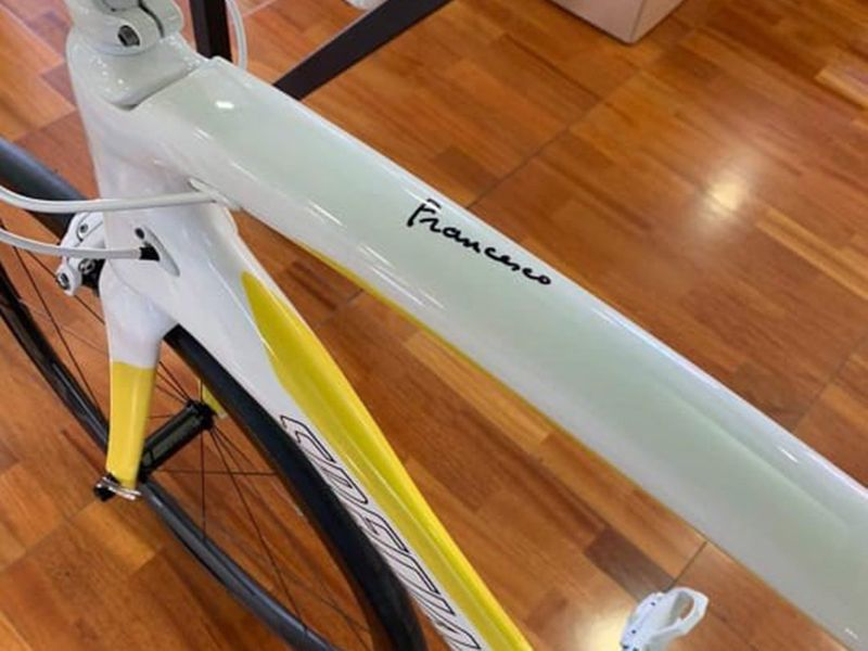 The bike is personalised with Pope Francis' signature