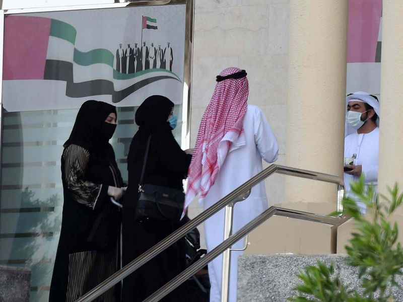 Dubai Court employees are seen at their office premises.
