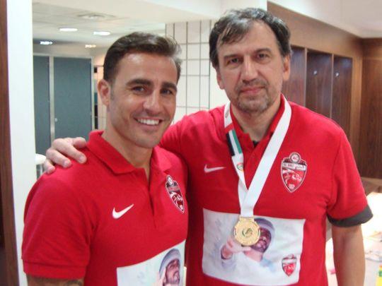 Faiq Huseynov with Fabio Cannavaro during his time at Al Ahil