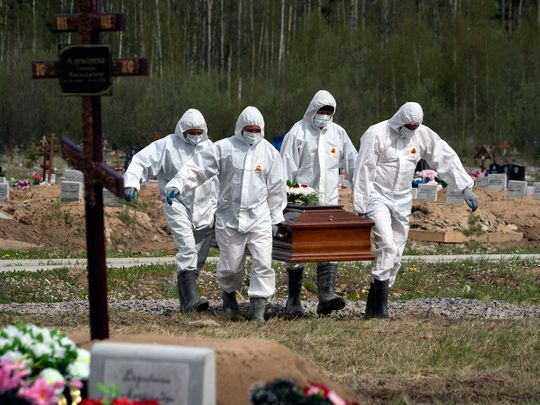 Gravediggers in protective suits