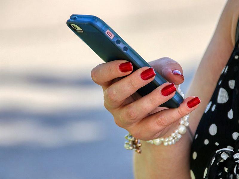 Woman using mobile phone, whatsapp