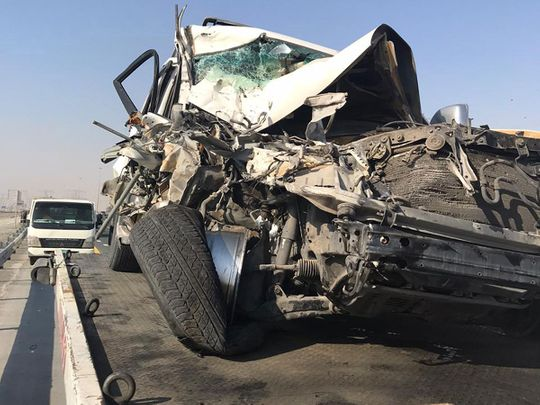 A Dubai pick-up driver's negligence has caused serious injuries to an Emirati, after he left his vehicle in the middle of the highway to speak to a fellow motorist