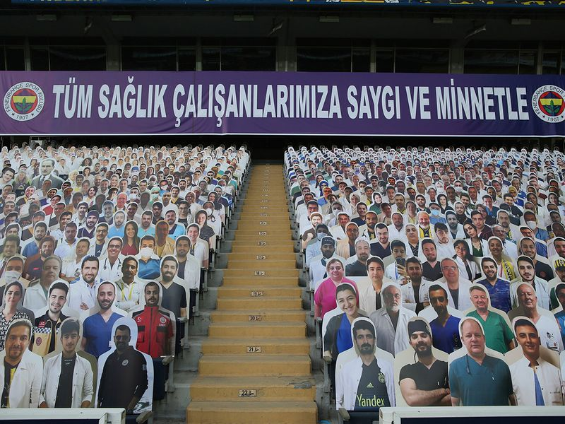 Cut-outs with photographs of medical staff on the stands prior to a Turkish Super League match between Fenerbahce and Kayserispor