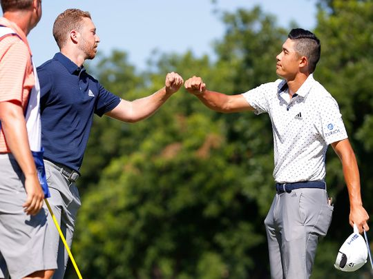 Daniel Berger is congratulated by Collin Morikawa after the play-off in the final round of the Charles Schwab Challenge.