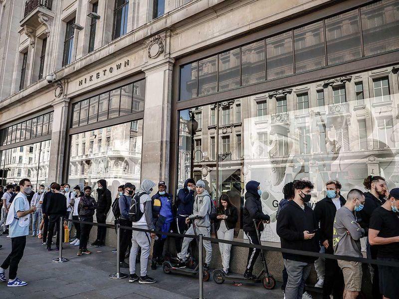 People queue shop London