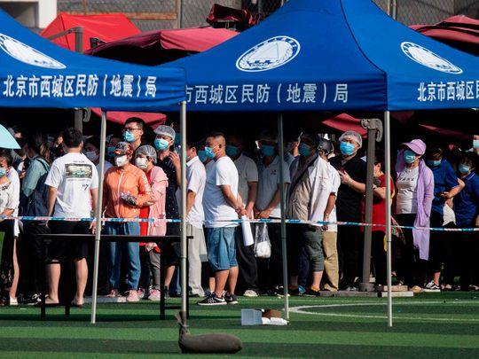 Xinfadi Market China curbs travel