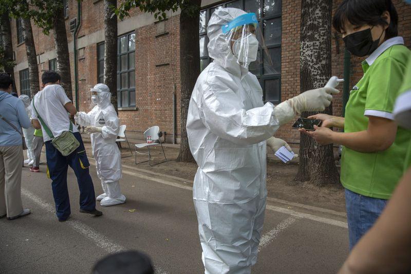 Copy of Virus_Outbreak_China_Tests_Photo_Essay_22695.jpg-c5fb0~1-1592468758437