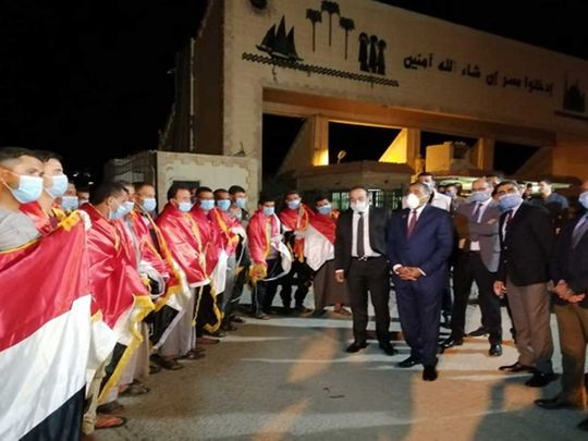 Egyptians, returning from Libya, are received at the Al Saloum border crossing.