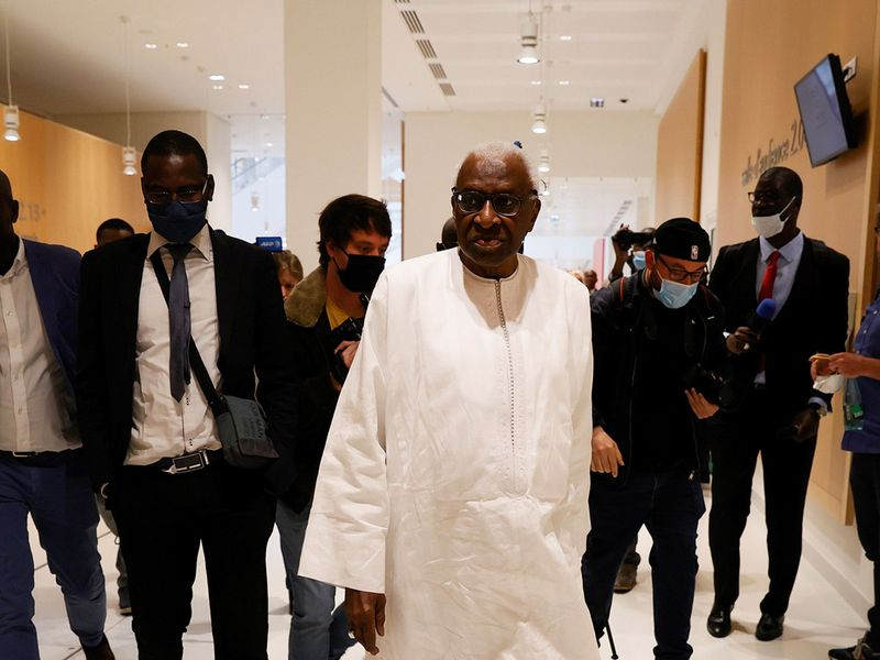 Lamine Diack, former head of IAAF, leaves the courthouse in Paris