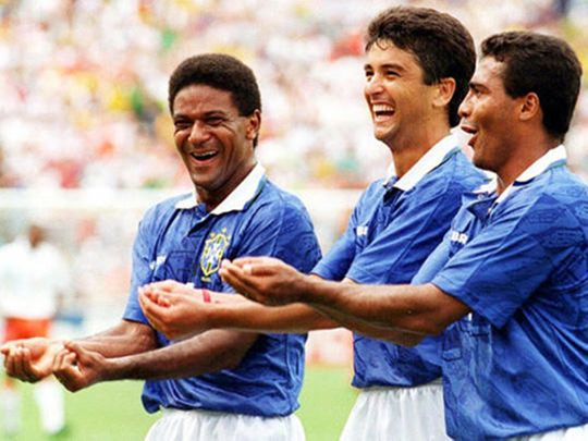 Bebeto, centre, creates a moment of history with his celebration at USA 94.
