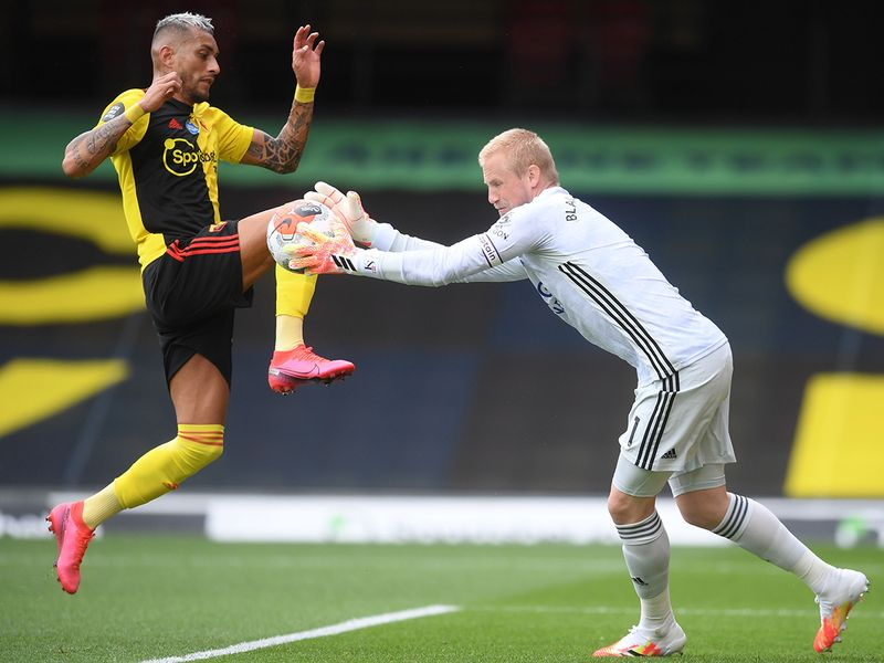 Kasper Schmeichel gets to the ball ahead of Watford's Roberto Pereyra.
