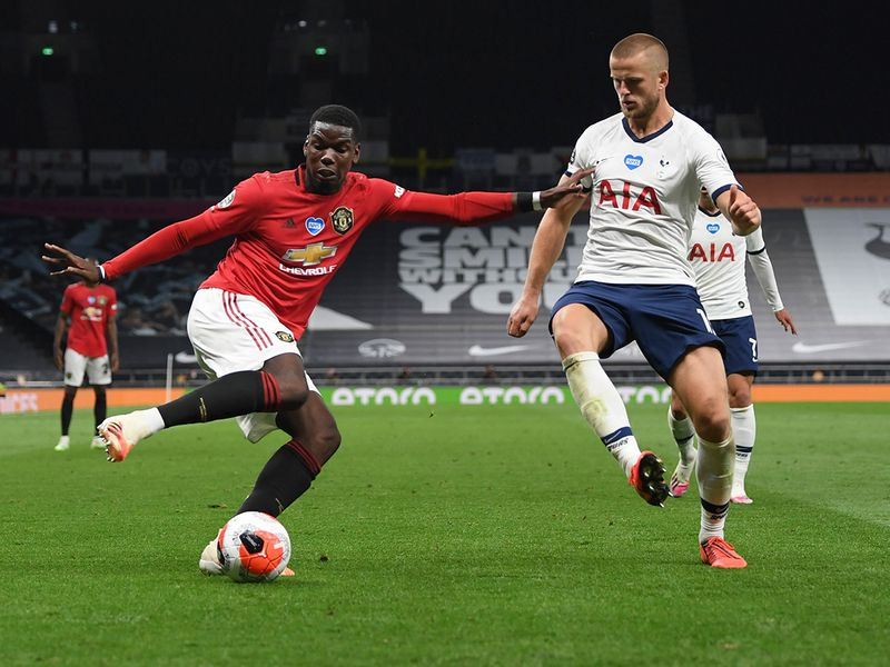 Manchester United's Paul Pogba, left, is challenged by Tottenham's Eric Dier during the English Premier League match in London.